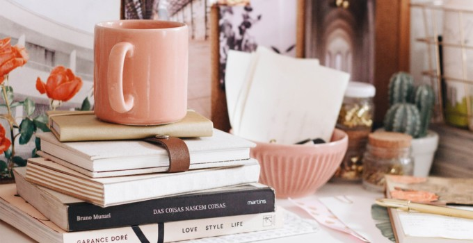 Using Facebook to Market your Writing featured blog image coffee mug on top of a pile of books