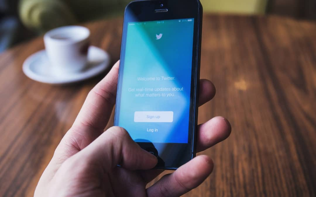How to Maximize your Presence on Twitter using Automation blog featured photo mobile phone showing Twitter logo