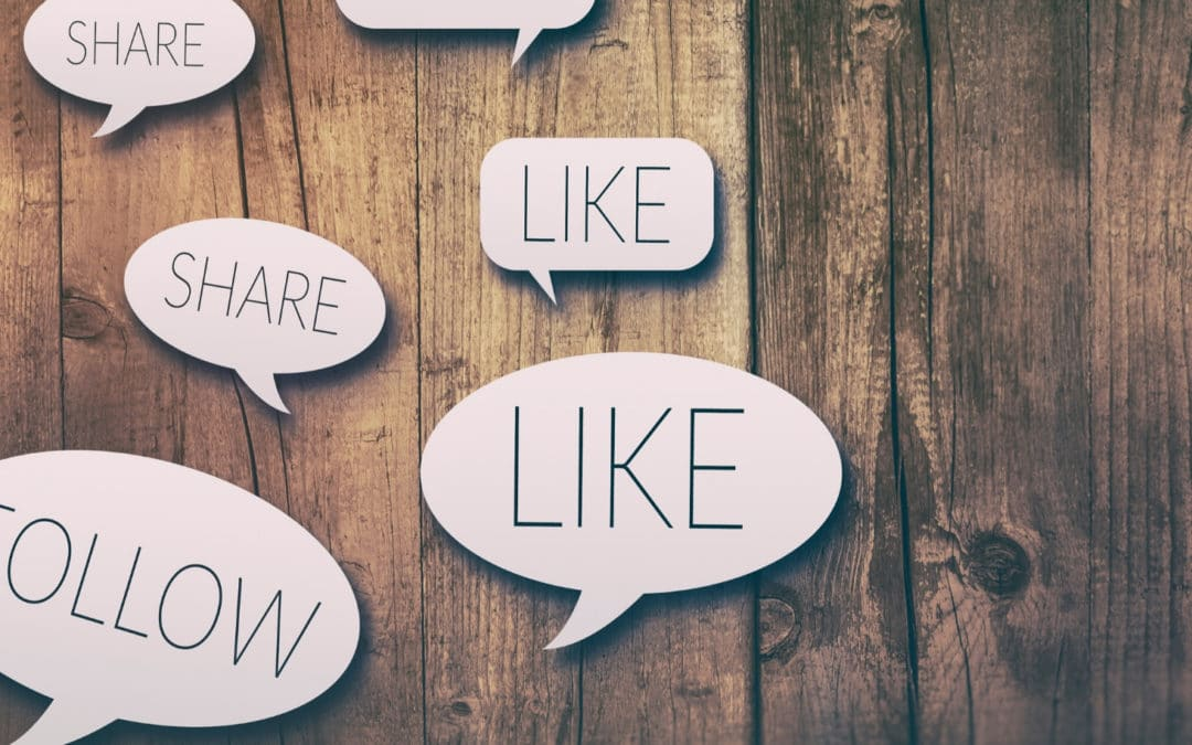 What to do when you get Overwhelmed by the Social Media Marketing World blog featured post engagement speech bubbles on top of a wooden table