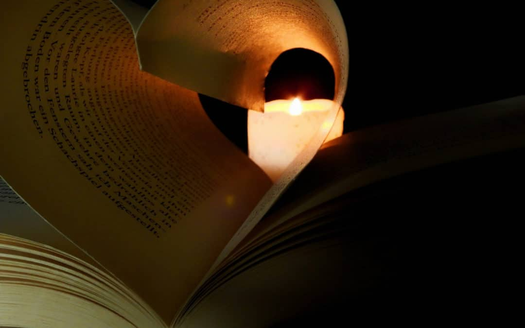 5 Things to Keep in Mind when Revising blog featured image book pages shaped like a heart with a candle in the end