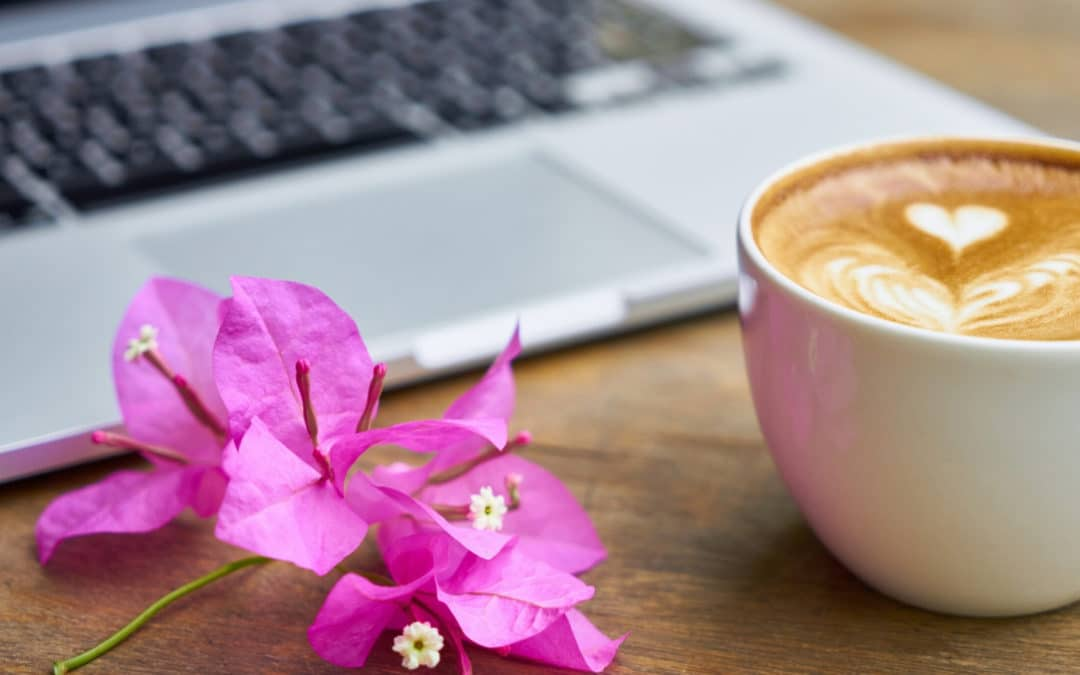 Stop Telling Writers they Have to Wake up Early if They Want to Write blog featured image flower and a coffee in front of a laptop