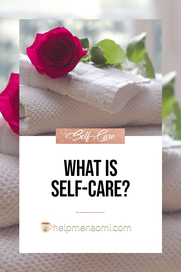 What is self-care? Blog title over roses laying on top of a pile of white towels