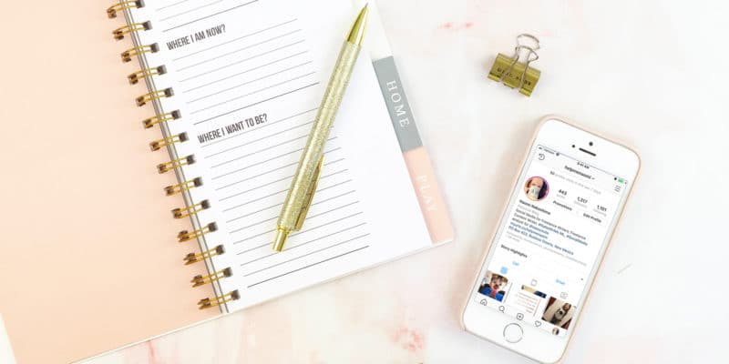 How to Find Great Hashtags to Market your Freelance Writing Business on Instagram Instagram screenshot on iPhone laying on desk