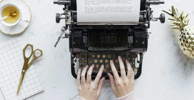 What is NaNoWriMo featured image typing on typewriter